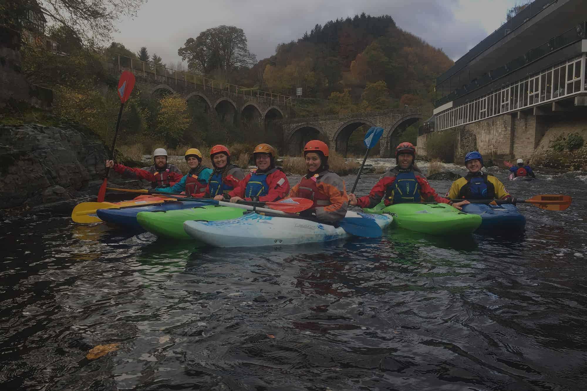team kayaking in Wales